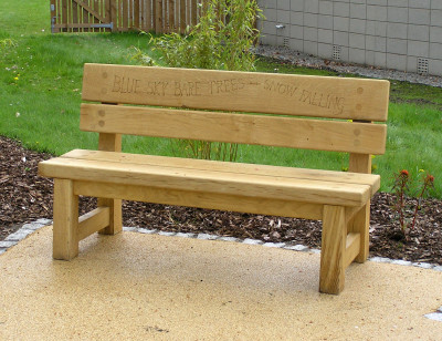 Engraved green oak poem bench